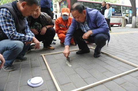 В Китаї запровадили новий спосіб перевірки якості роботи двірників: зважування пилі